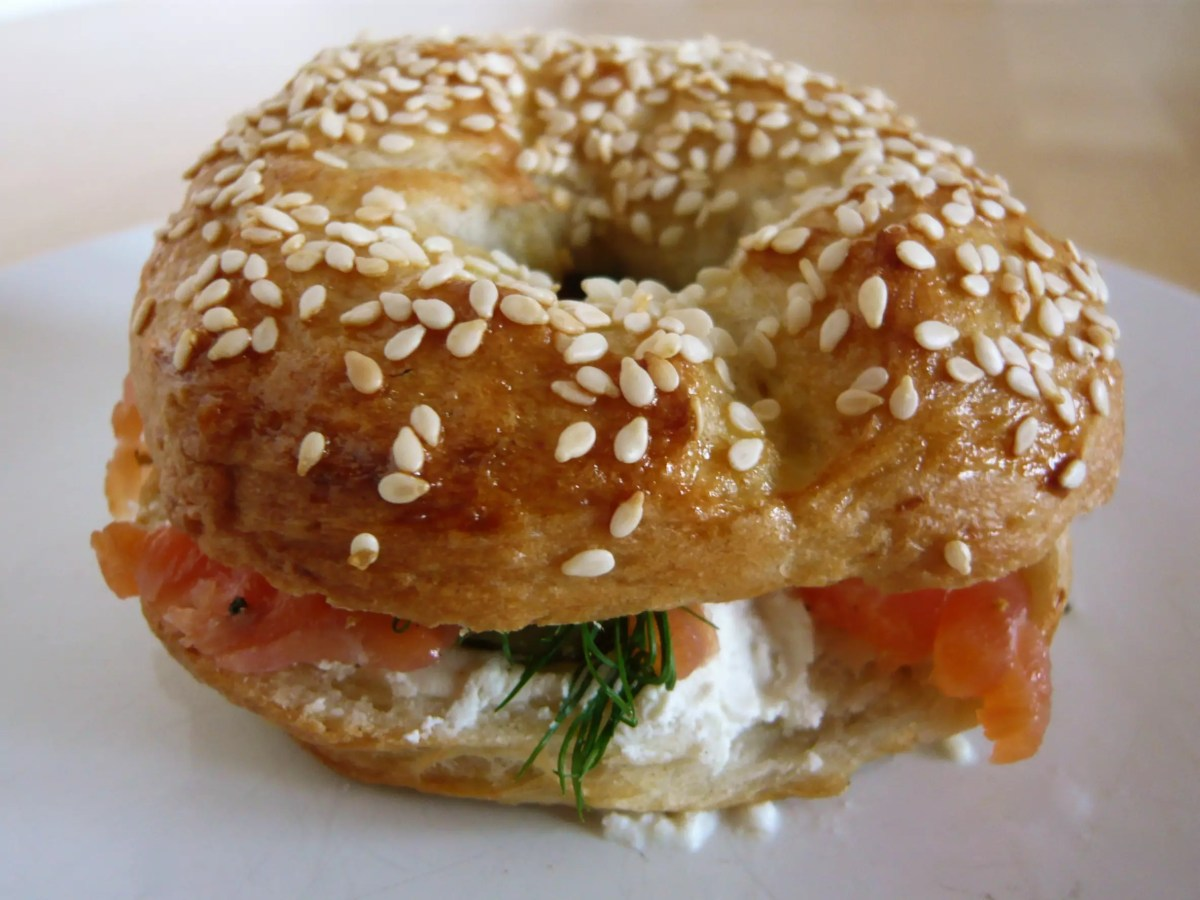 A sandwhich made with toasted Begels, tomato and cream cheese