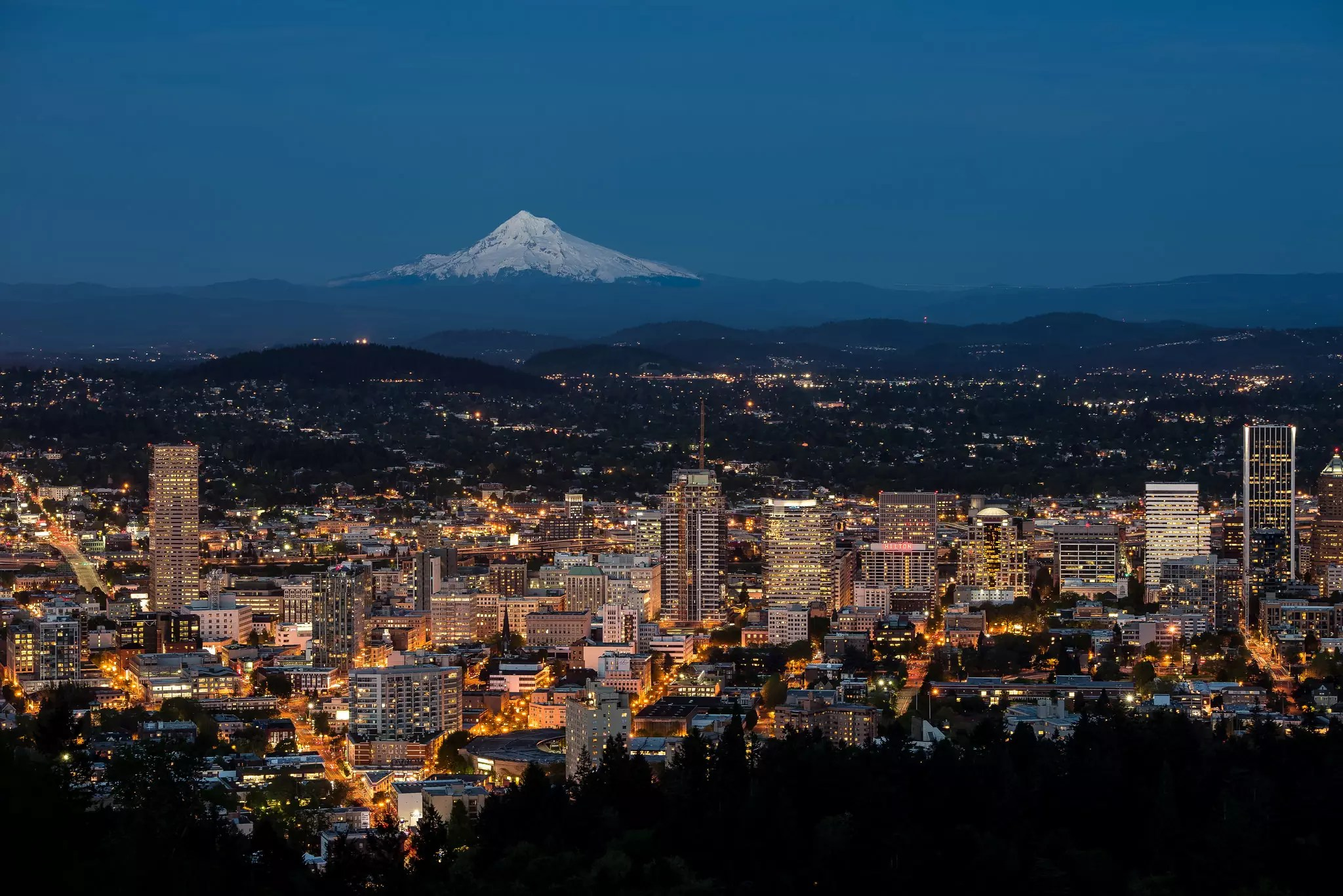 Portland, Oregon skyline at sunset from Pittock Mansion - photo by Jeff Hintzman under CC BY-ND 2.0