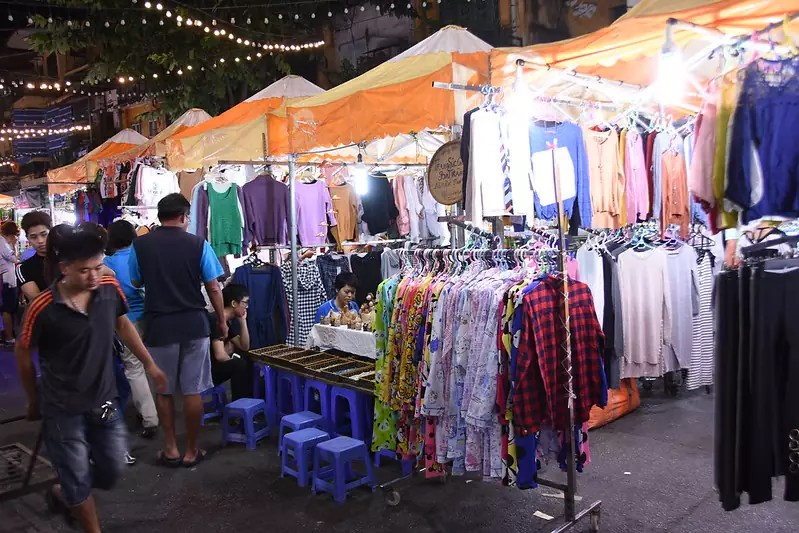 best shopping in Hanoi - Stalls selling clothing in the Hanoi Night Market in the Old Quarter - photo by shankar s. under CC BY 2.0