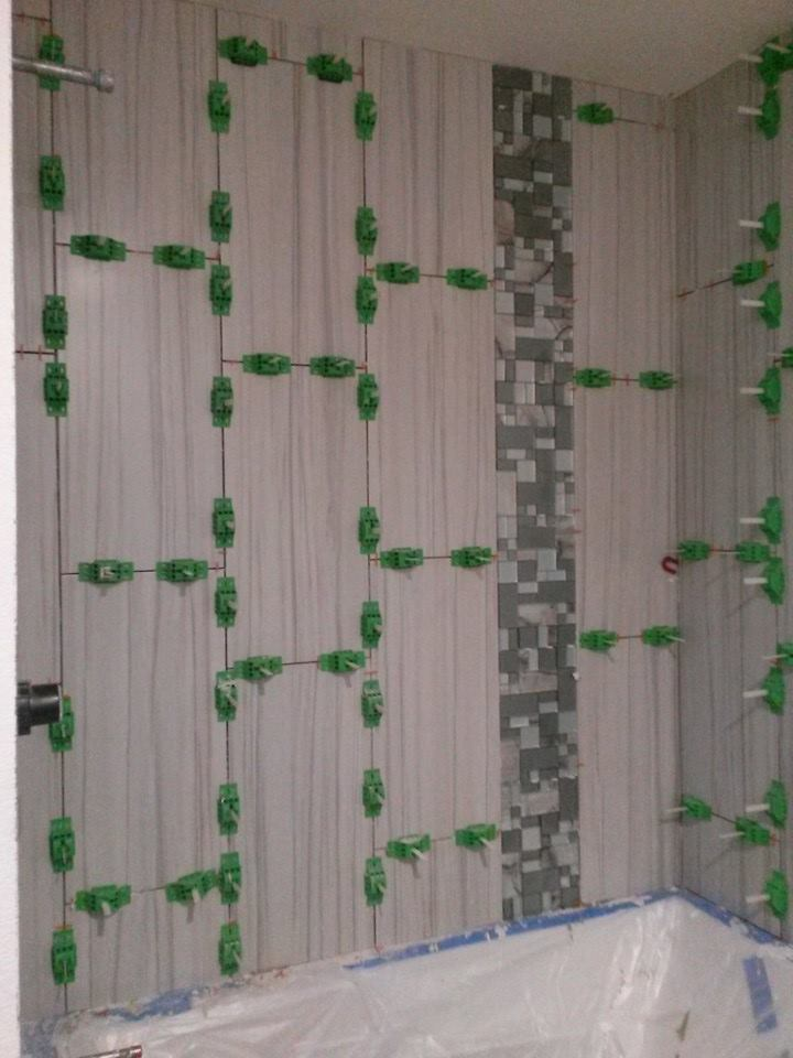 who makes the best tile leveling system