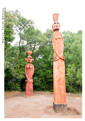 Couple of mapuchean totems at Temuco, Chile.