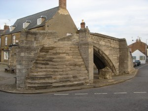 Trinity Bridge in Crowland Town, Lincolnshire. The triangular Trinity Bridge stands on dry land. Built between 1360 and 1390