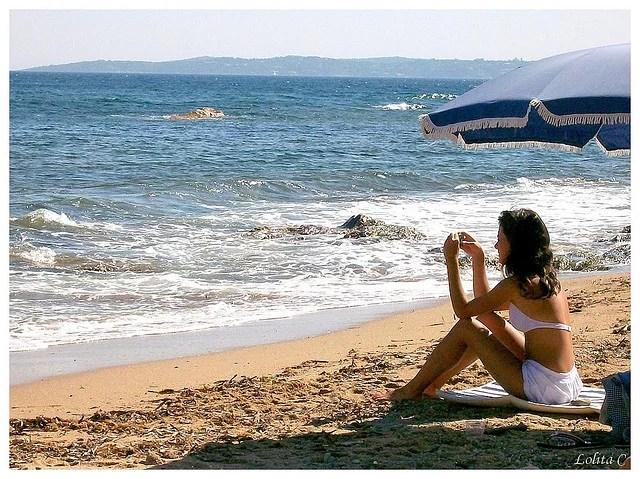 Vacances, plage - Crédit photo : Lolita C. via Flickr (CC BY-ND 2.0)