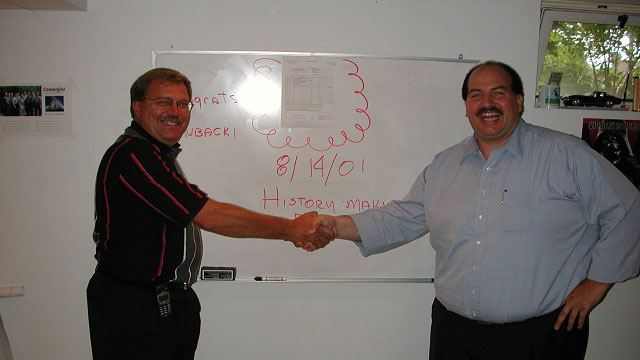 Colleagues shaking hands header image