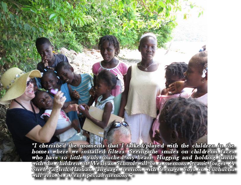 Colleague Cynthia with Haiti children laughing