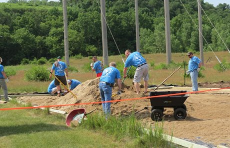 Convergint day Minnesota colleagues working in the sand