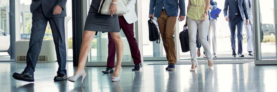 Business Colleagues entering a building