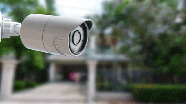 Video surveillance camera on wall