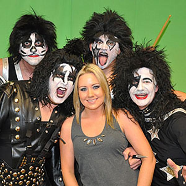 Women colleague takes picture with KISS the band