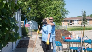 Convergint day Chicago colleagues gardening
