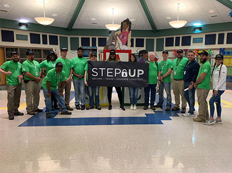 Convergint STEP Up team posing with banner