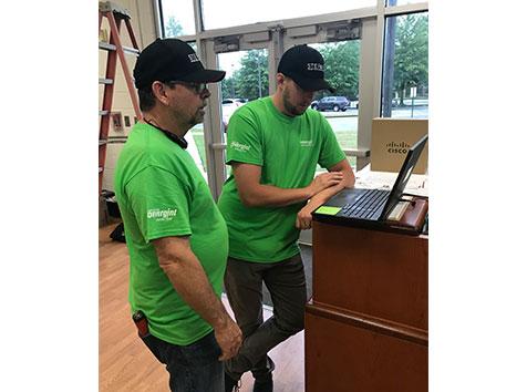men working on computer