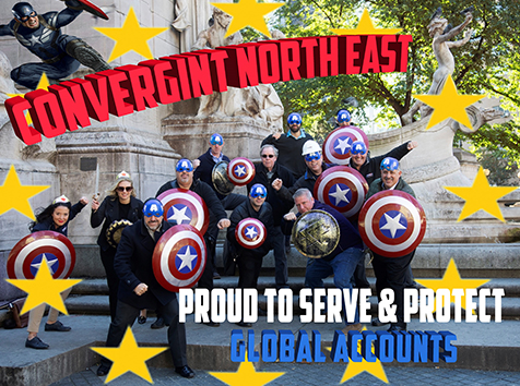 People posing with shields with text saying Convergint Northeast Proud to serve & Protect Global Accounts