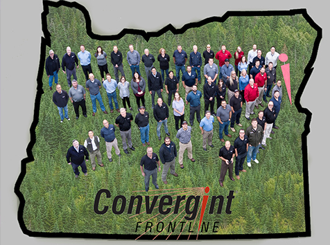 People standing on an outline of the state of Oregon