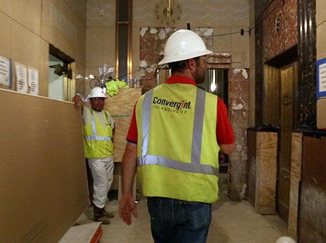 man walking a construction site