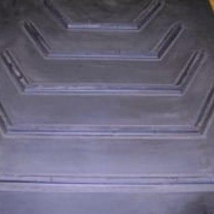 Closeup of bucket cleat belting