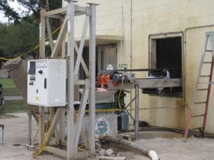 Exterior view of conveyor system at wastewater treatment plant