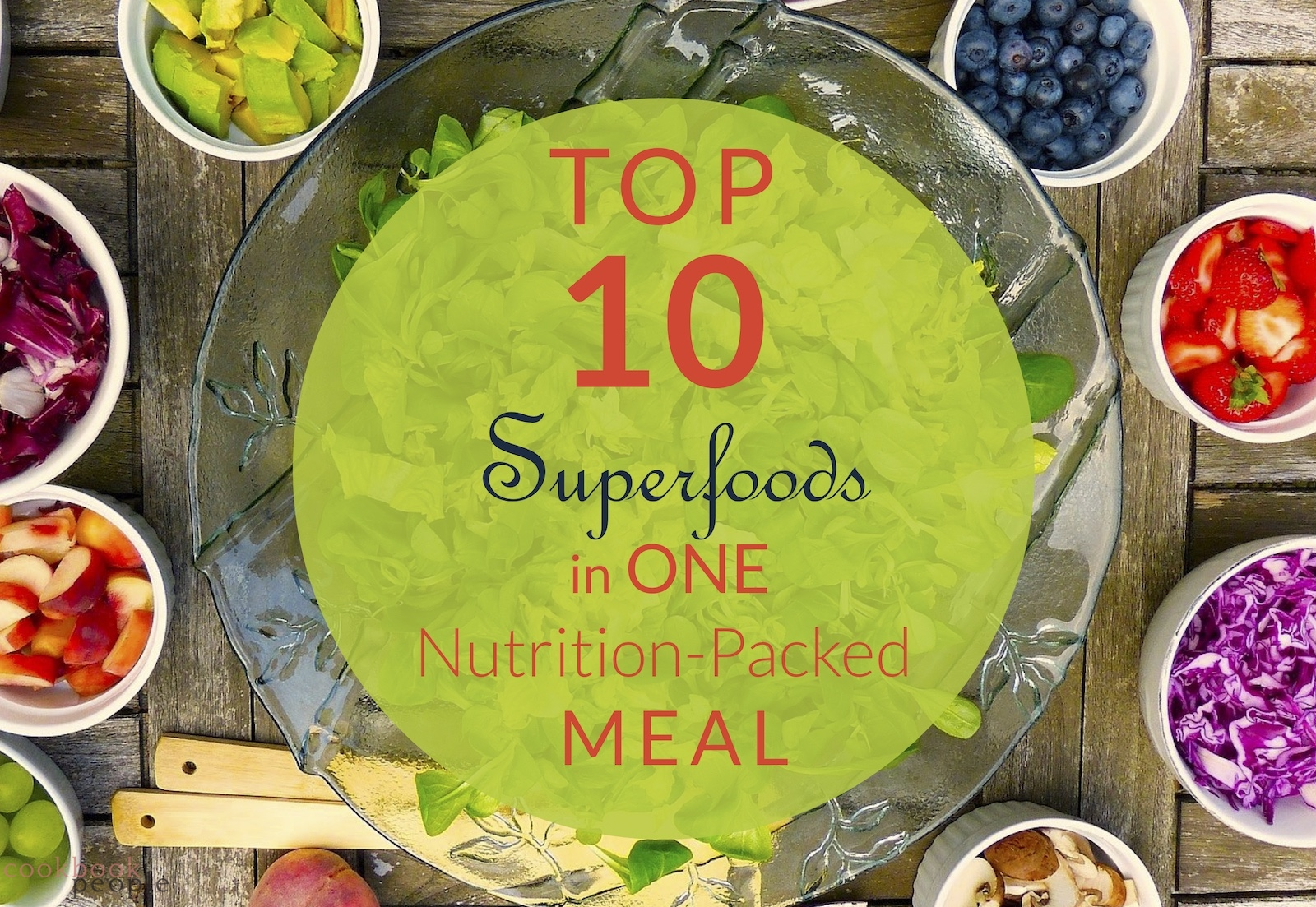 Bowl of salad surrounded by small bowls of other healthy ingredients with text: Top 10 Superfoods in One Nutrition-Packed Meal