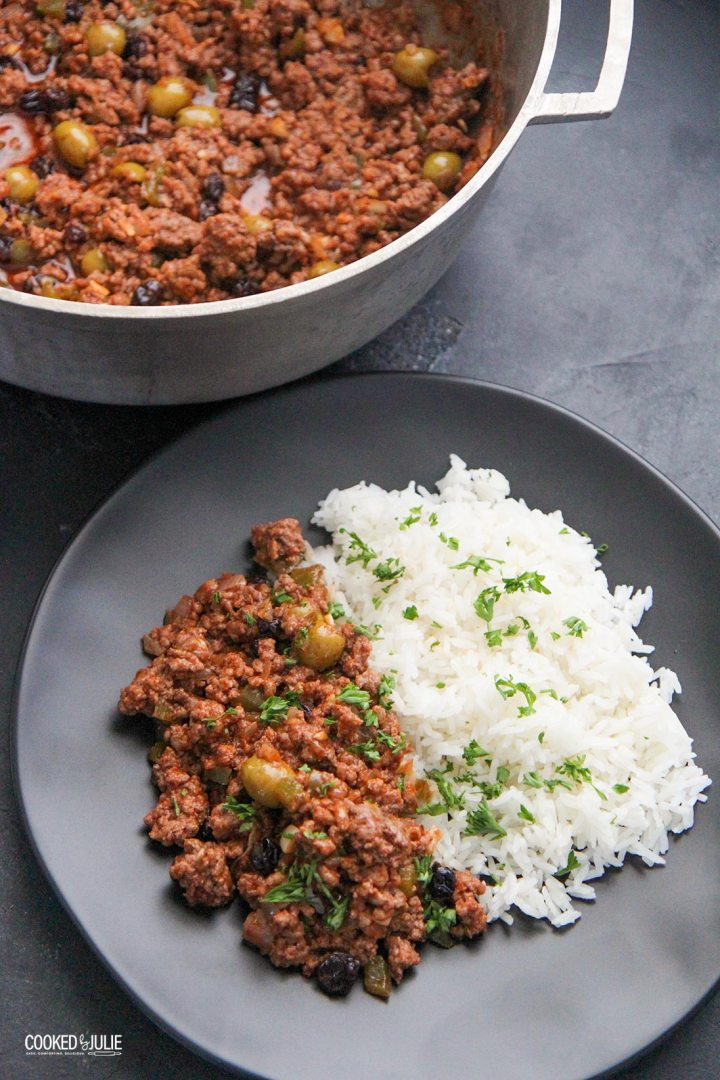 Cuban picadillo with rice on a black plate