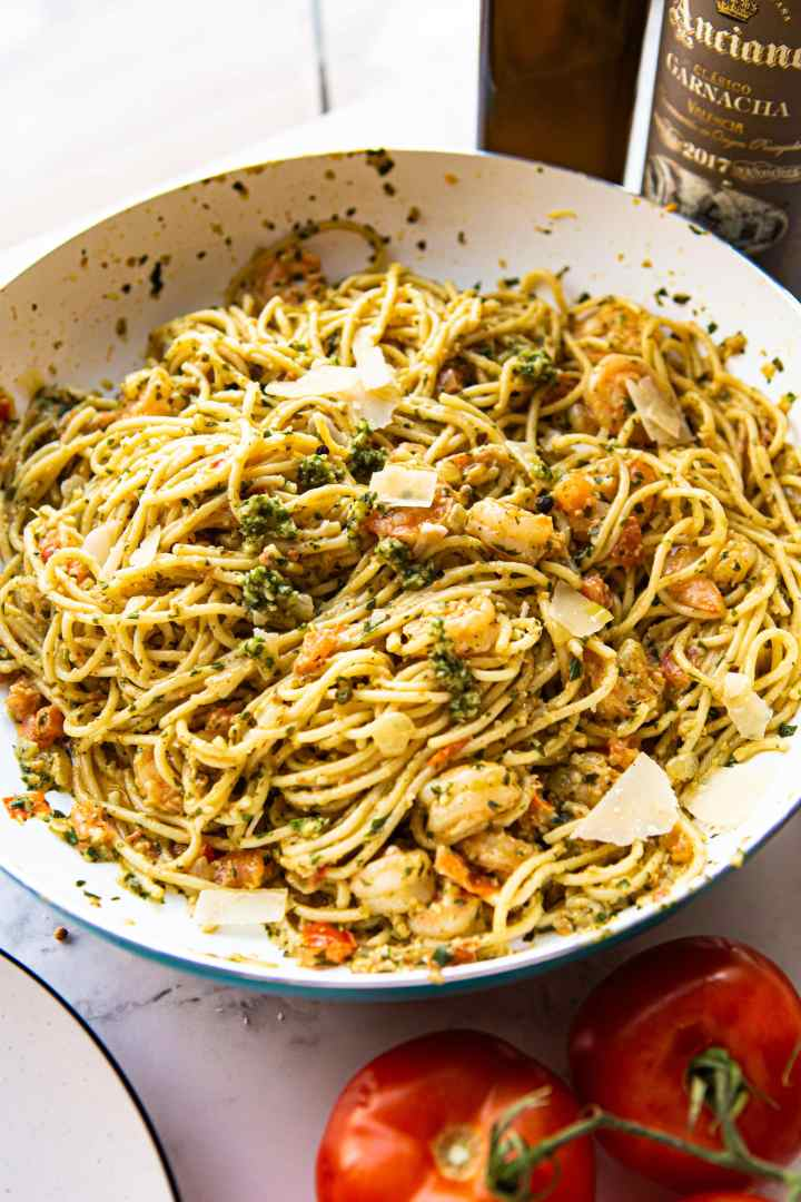 shrimp pesto pasta in a skillet.