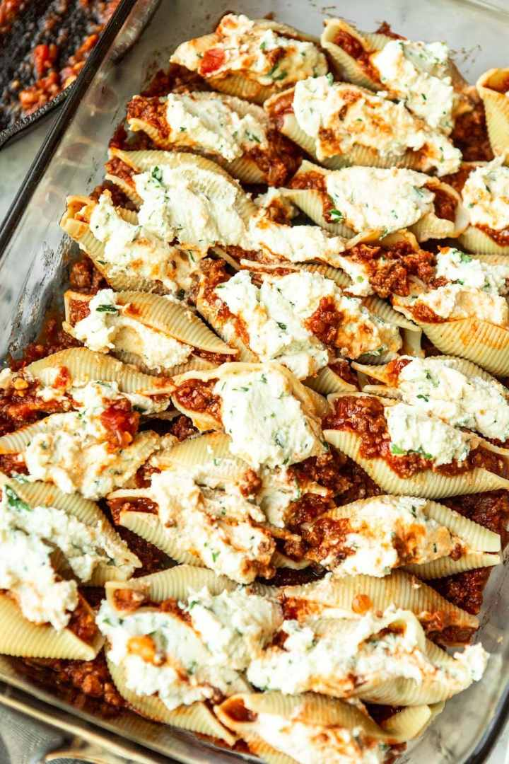 an entire casserole filled with meat sauce and stuffed shells.