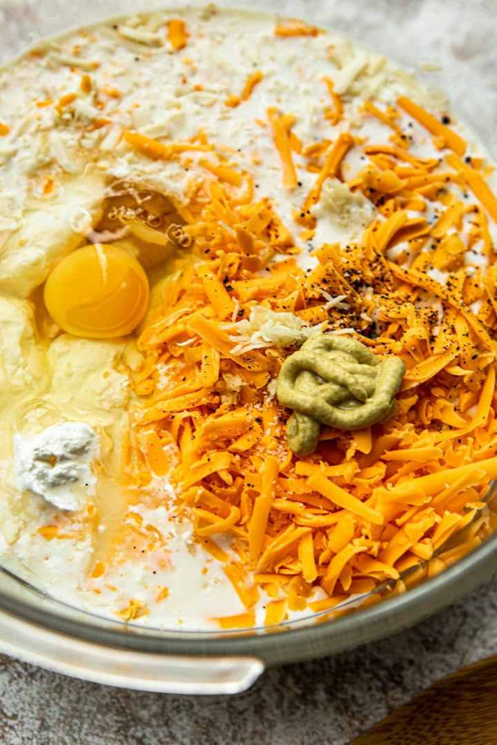 egg, mustard, cheese, and milk, in a large bowl.
