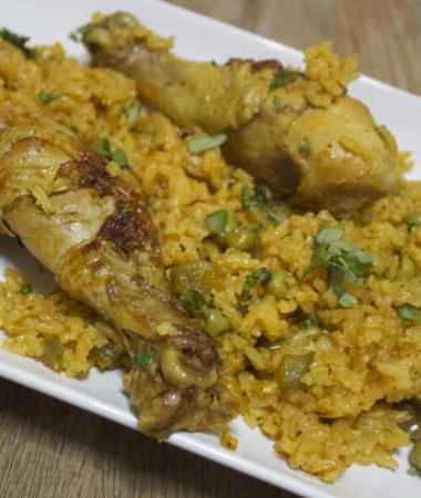 bone in chicken and yellow rice.
