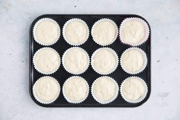 a cupcake tin with 12 cupcakes.
