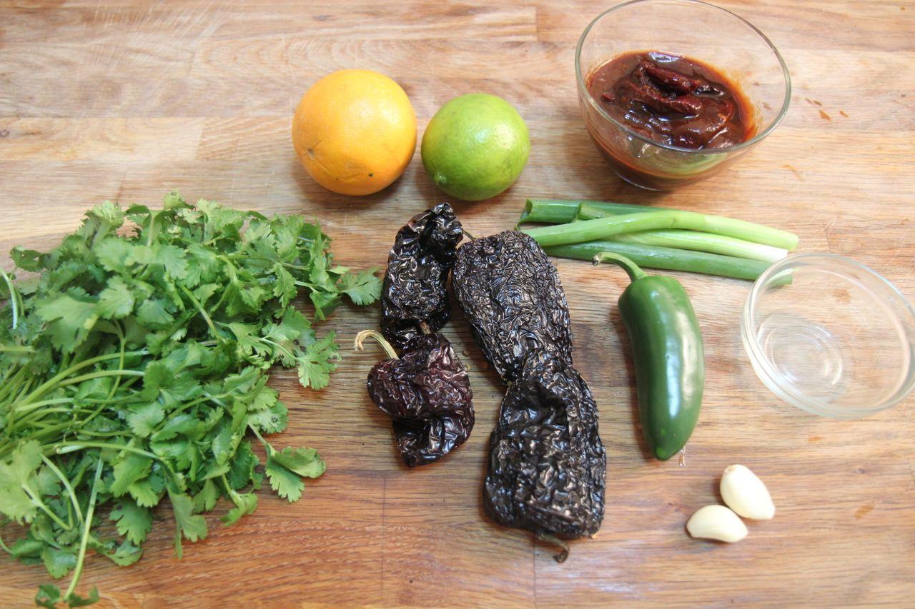 Carne asada taco ingredients include roasted chilis, cilantro, lemon and lime juice, garlic and marinated steak