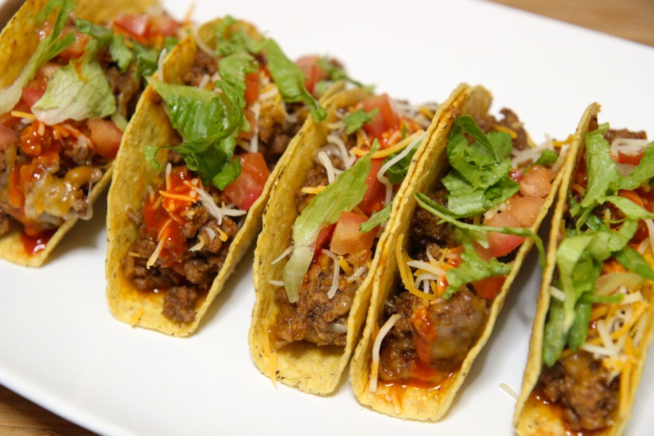 Crispy shell beef tacos with cheese, tomatoes and lettuce.