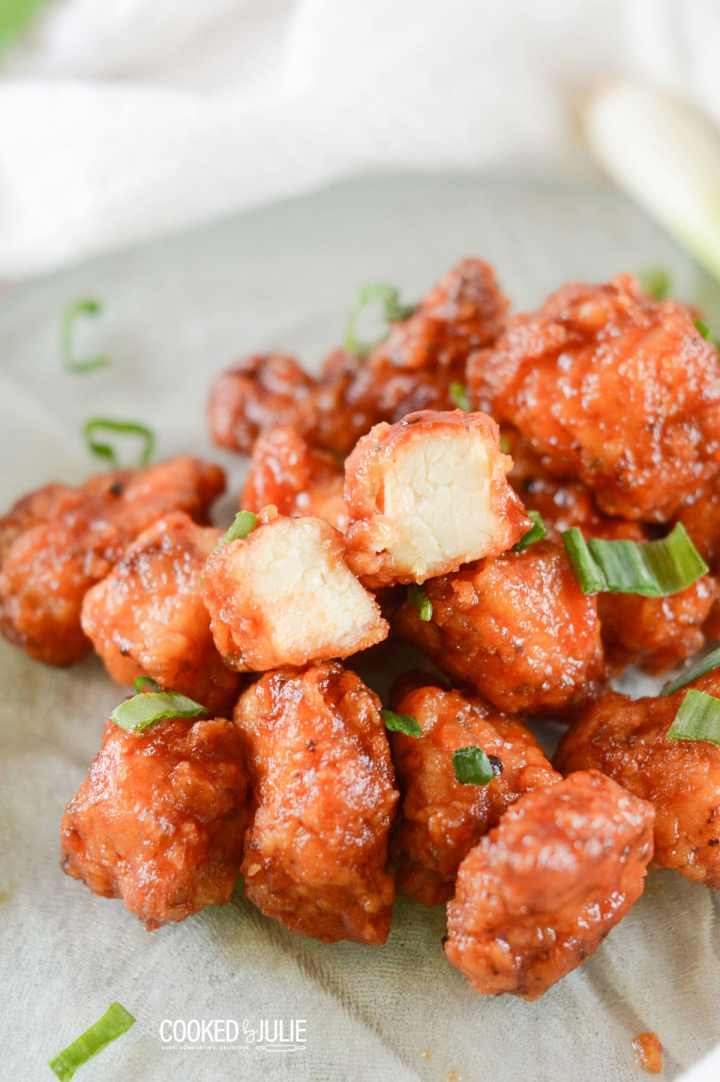 honey boneless bbq wings with scallions on a green plate