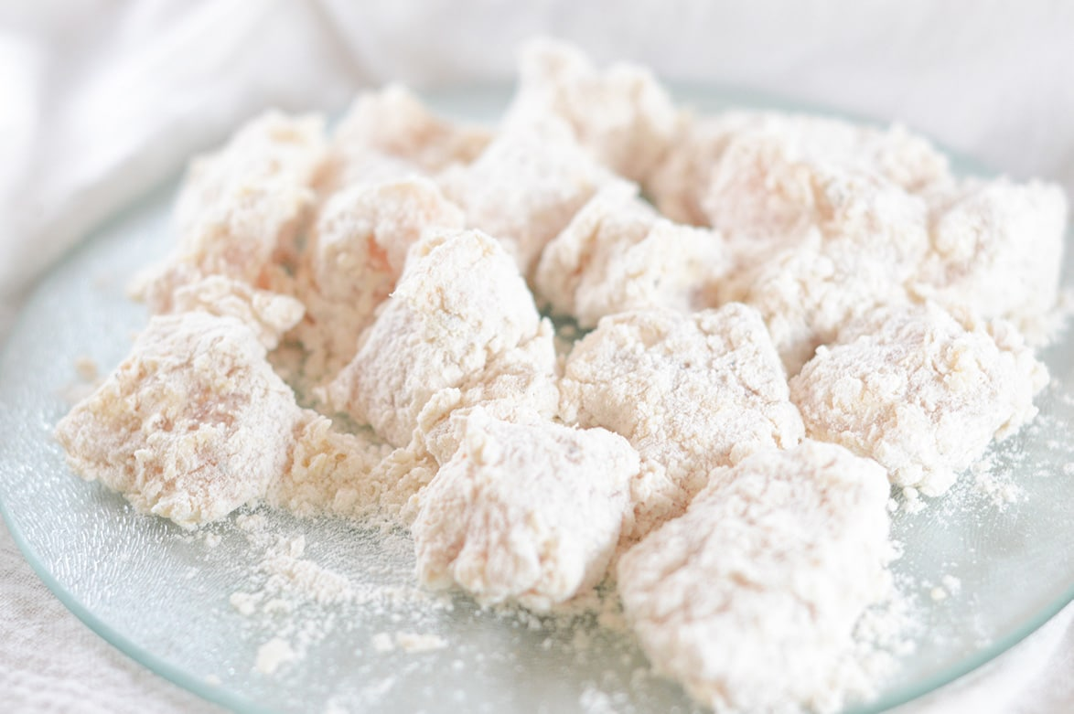 chicken coated in flour on a plate