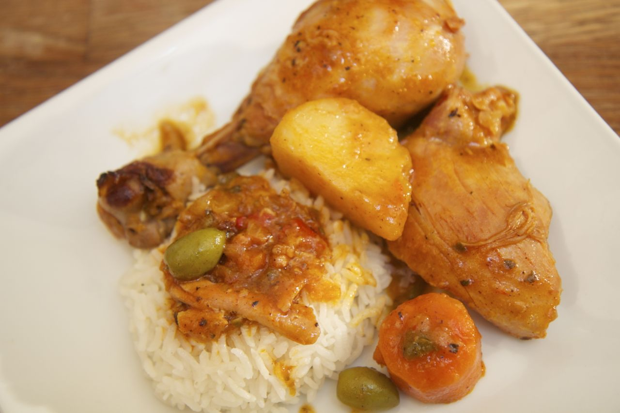 This tender and juice Cuban chicken fricassee is packed with flavor and spices and cooked to perfection.