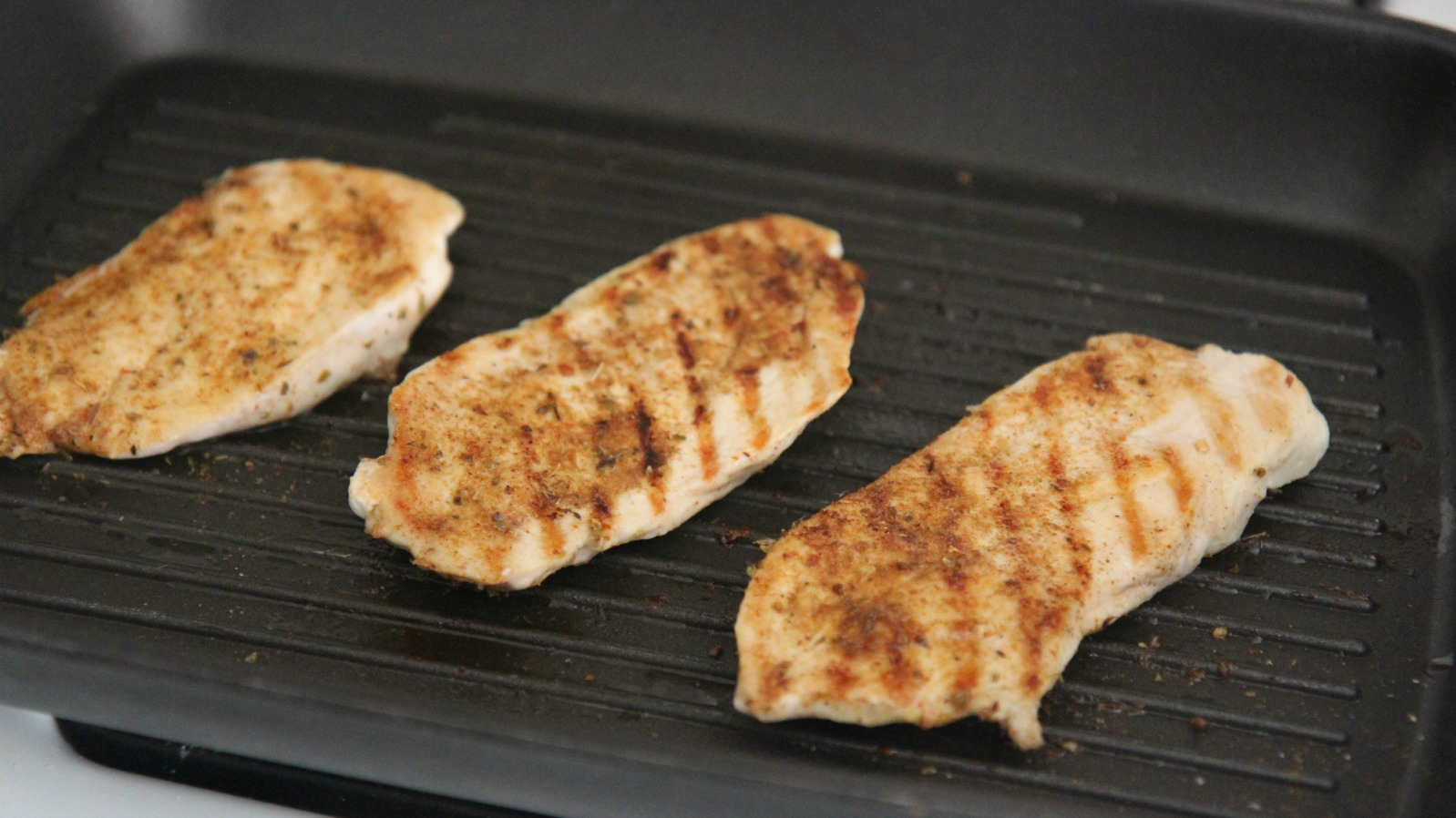 Grill or pan-fry the chicken breasts until cooked through.