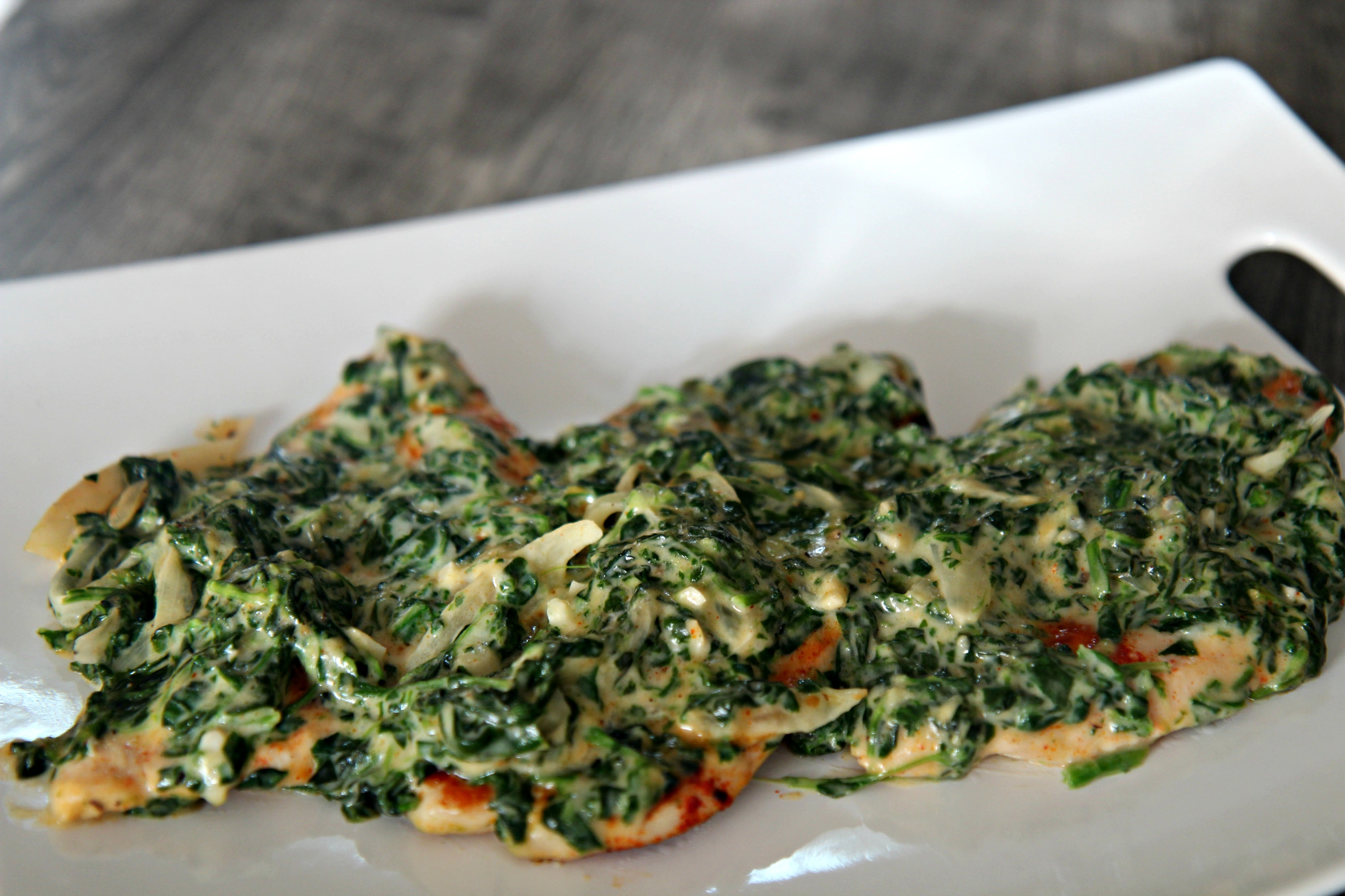 Tender and juicy chicken topped with delicious creamed spinach