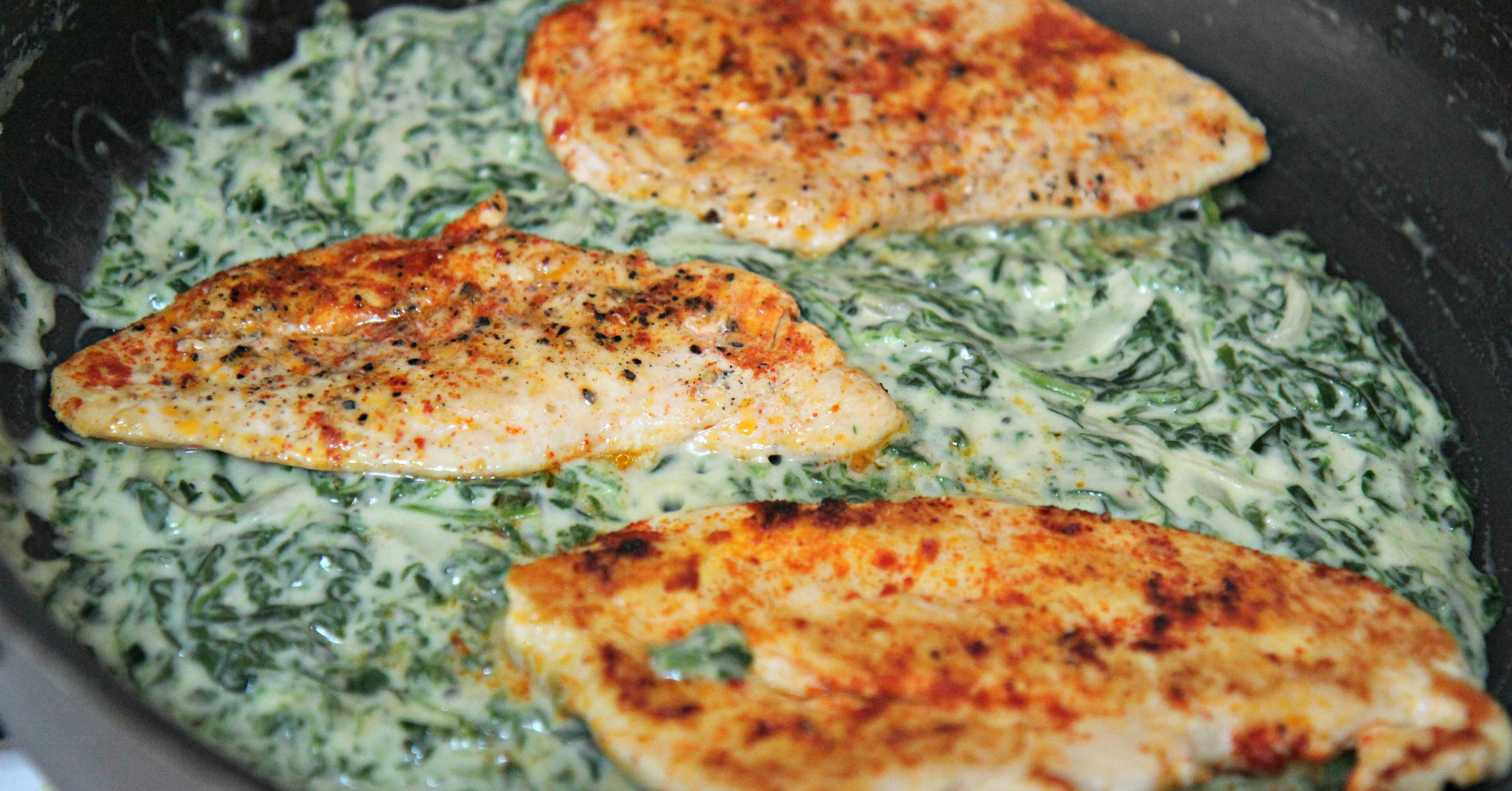 Perfectly seasoned chicken breast cooked in a creamy spinach sauce