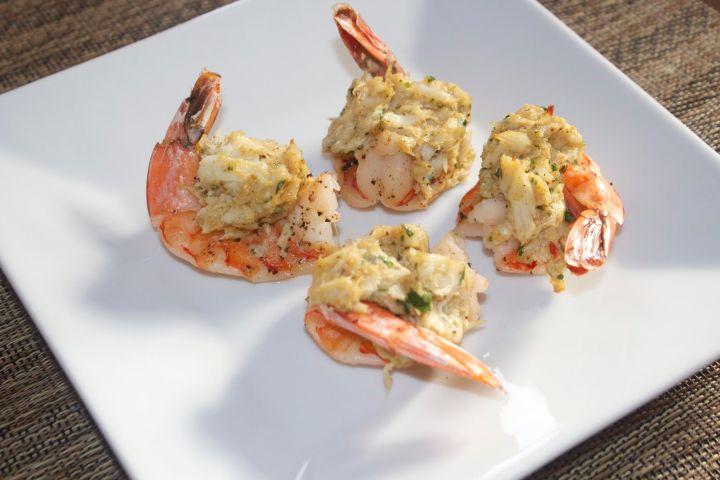 four stuffed shrimp on a white plate