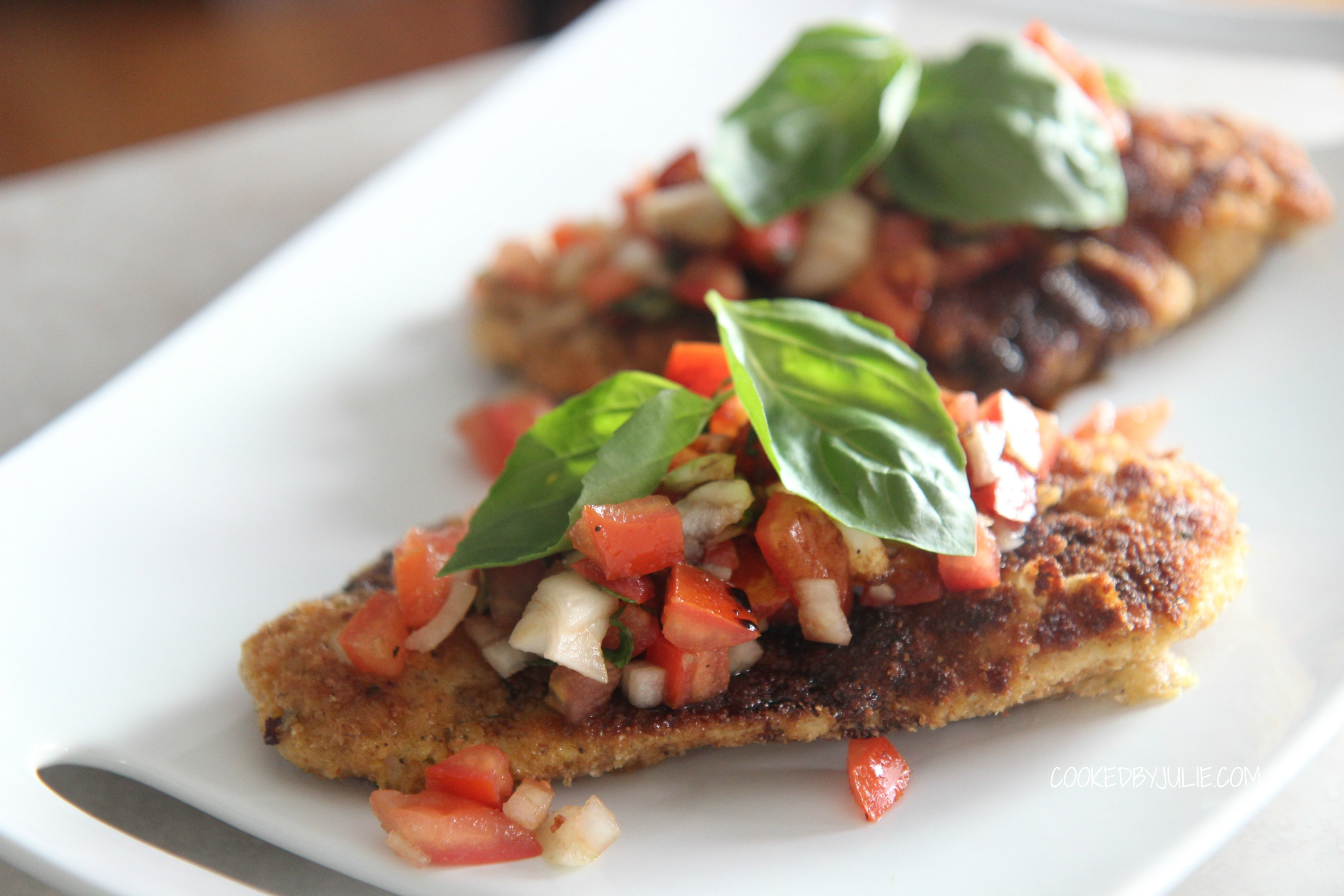Topped with fresh basil leaves and a fresh tomato mixture, this chicken bruschetta is light and delicious.