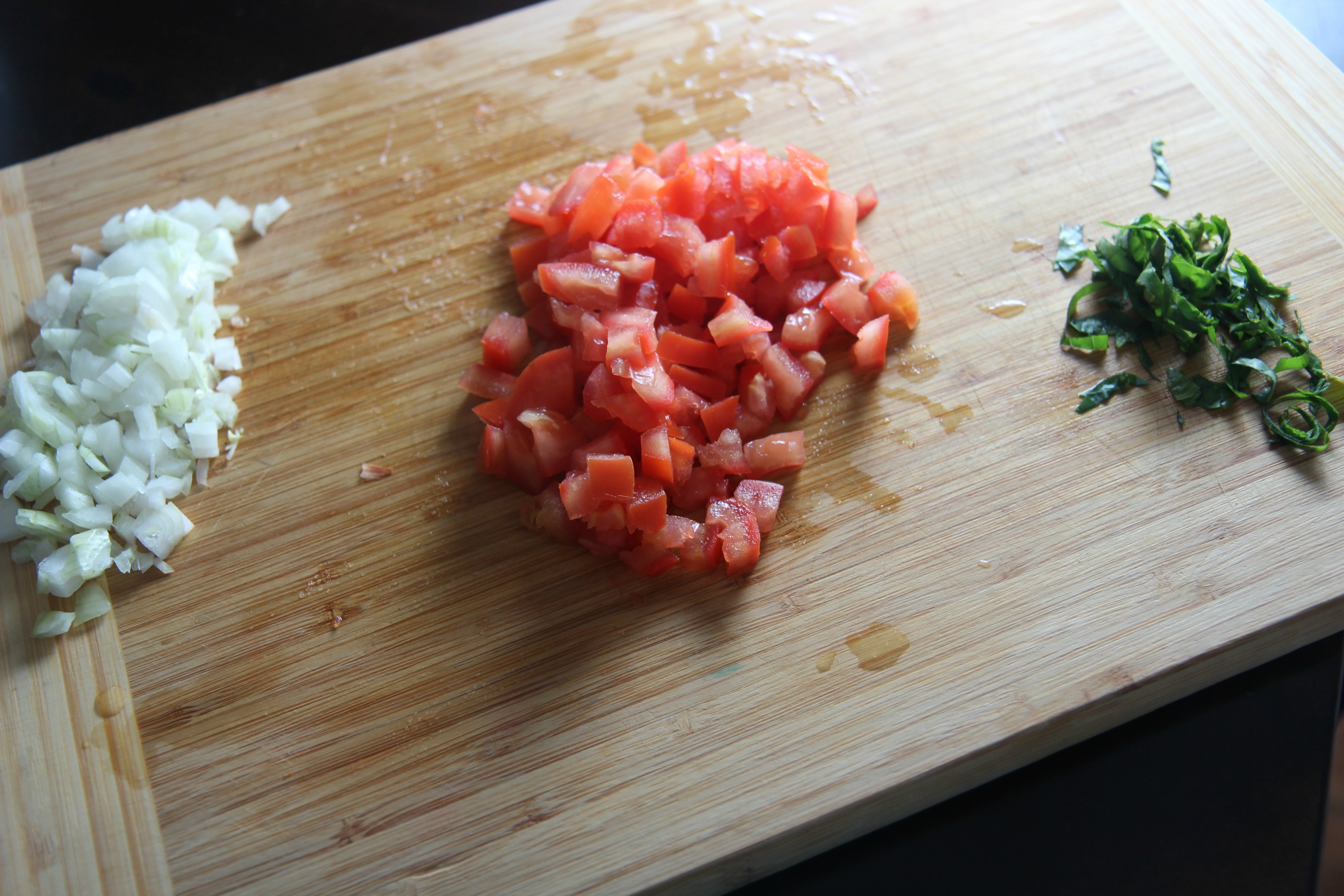 Chopped onions, tomatoes, and basil.