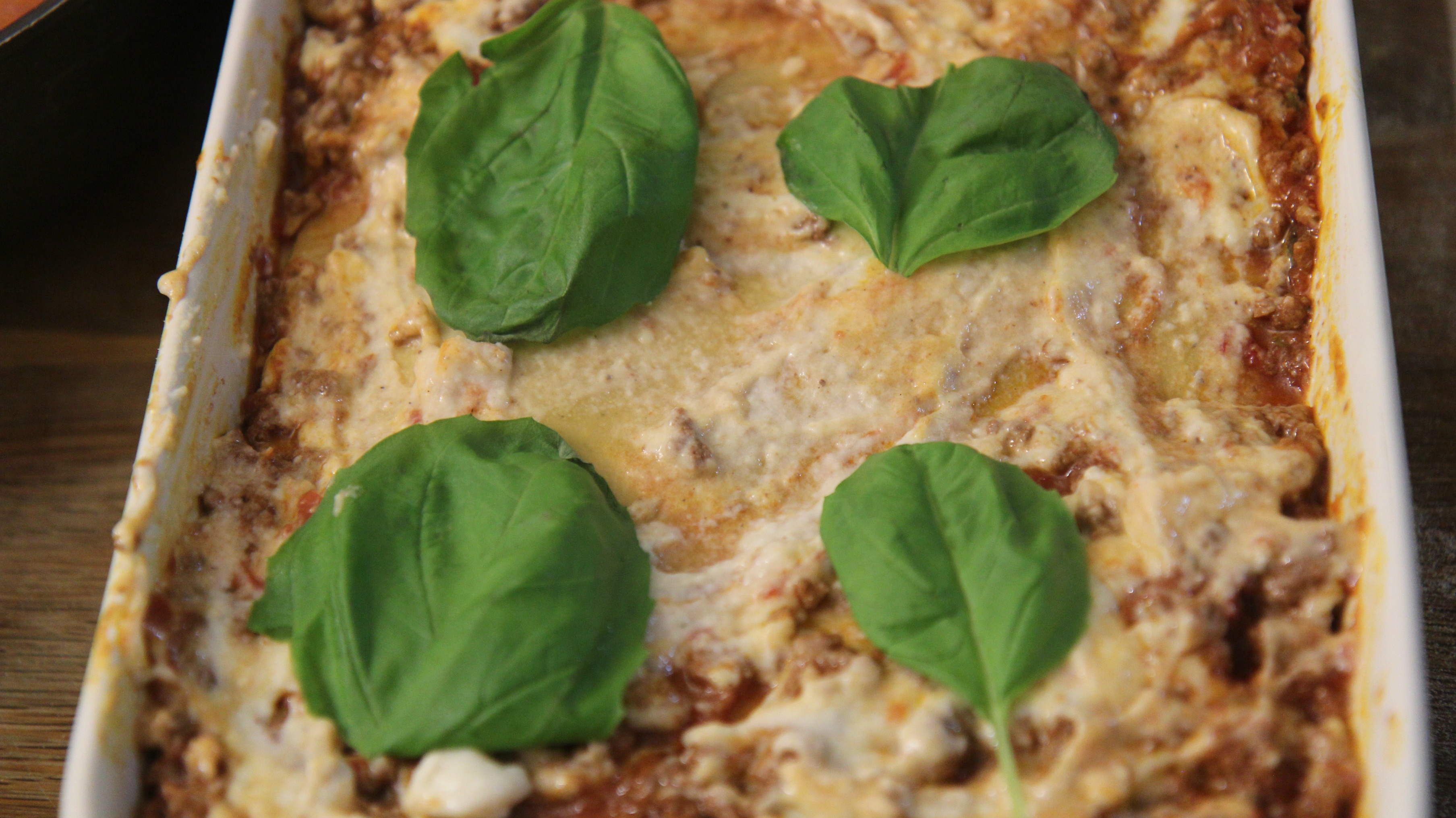 Add fresh basil under the cheese of this ultimate lasagna to add fresh flavor.