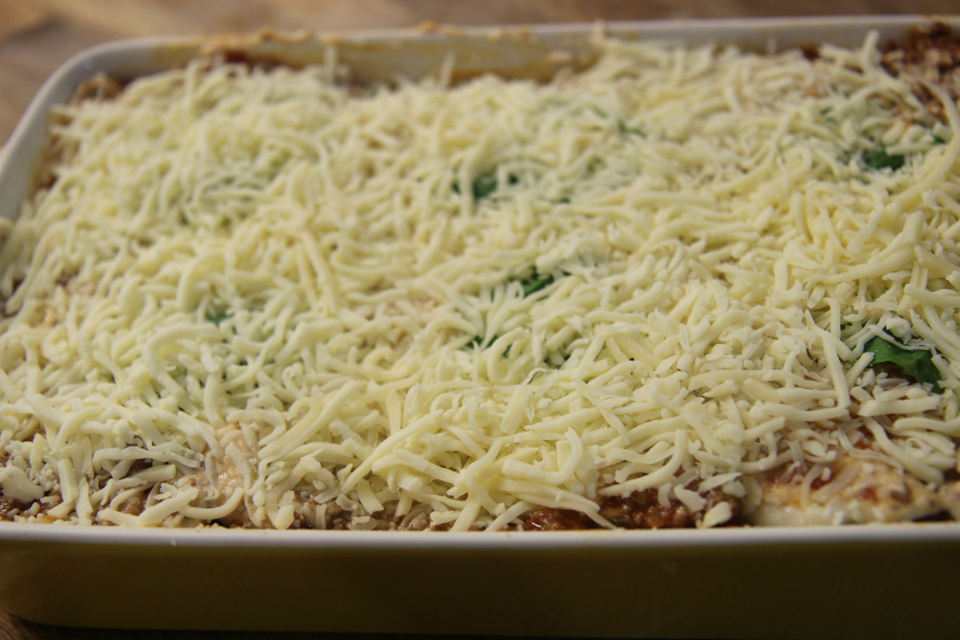 Pile on the cheese! I topped my lasagna with creamy italian cheese before baking in the oven.