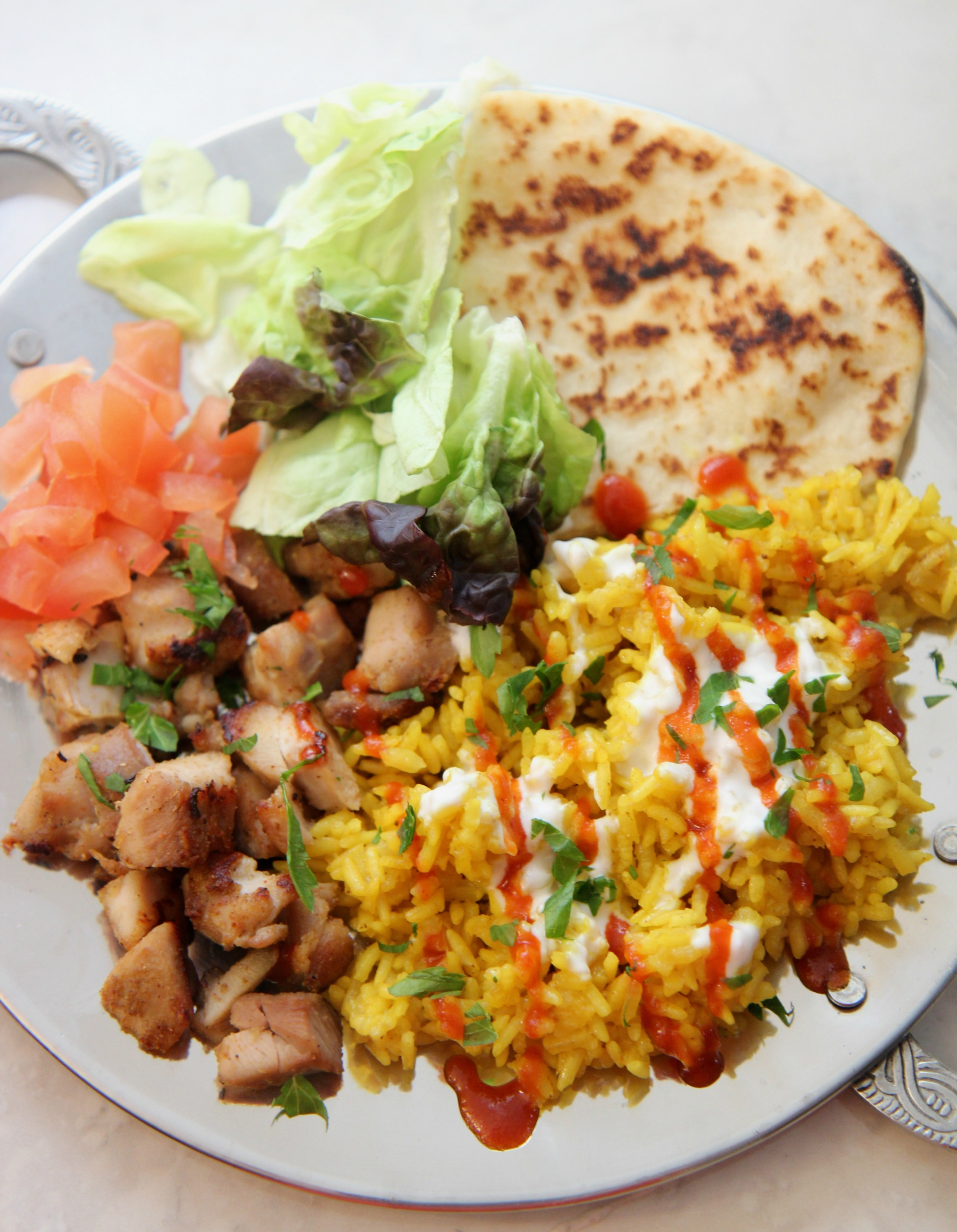 This Halal guys chicken and rice recipe is similar to what you'd get at a lunch cart in NYC.