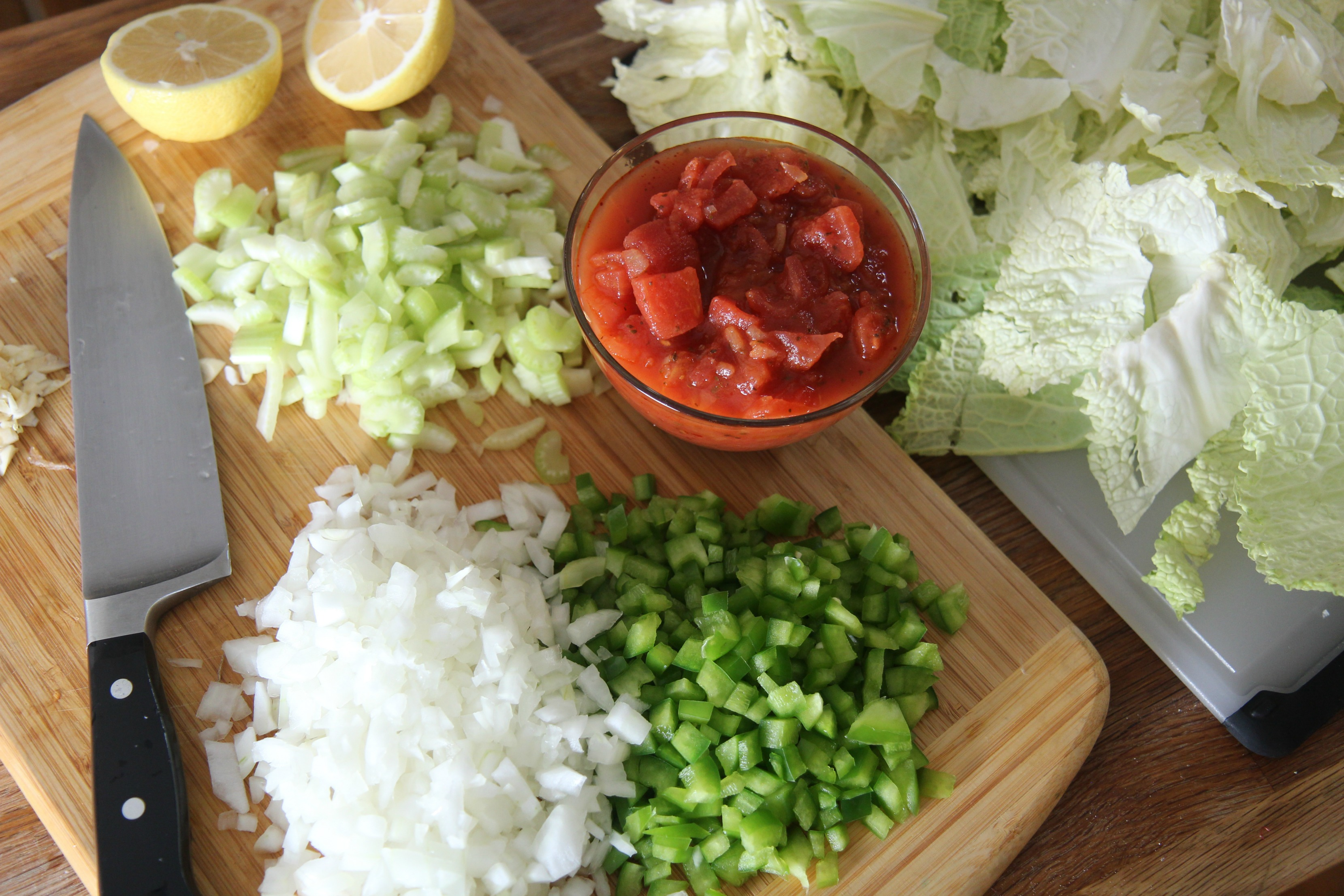 Detox diet cabbage soup recipe ingredients - fresh chopped vegetables and delicious lemon.