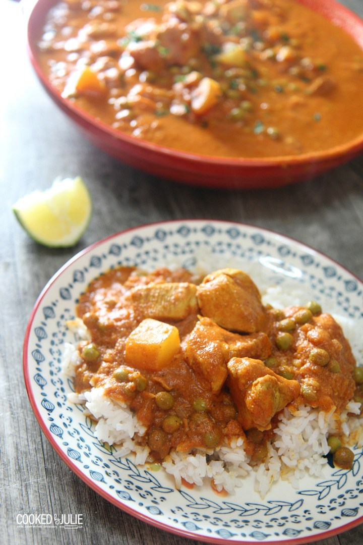 coconut chicken curry over rice on a small plate