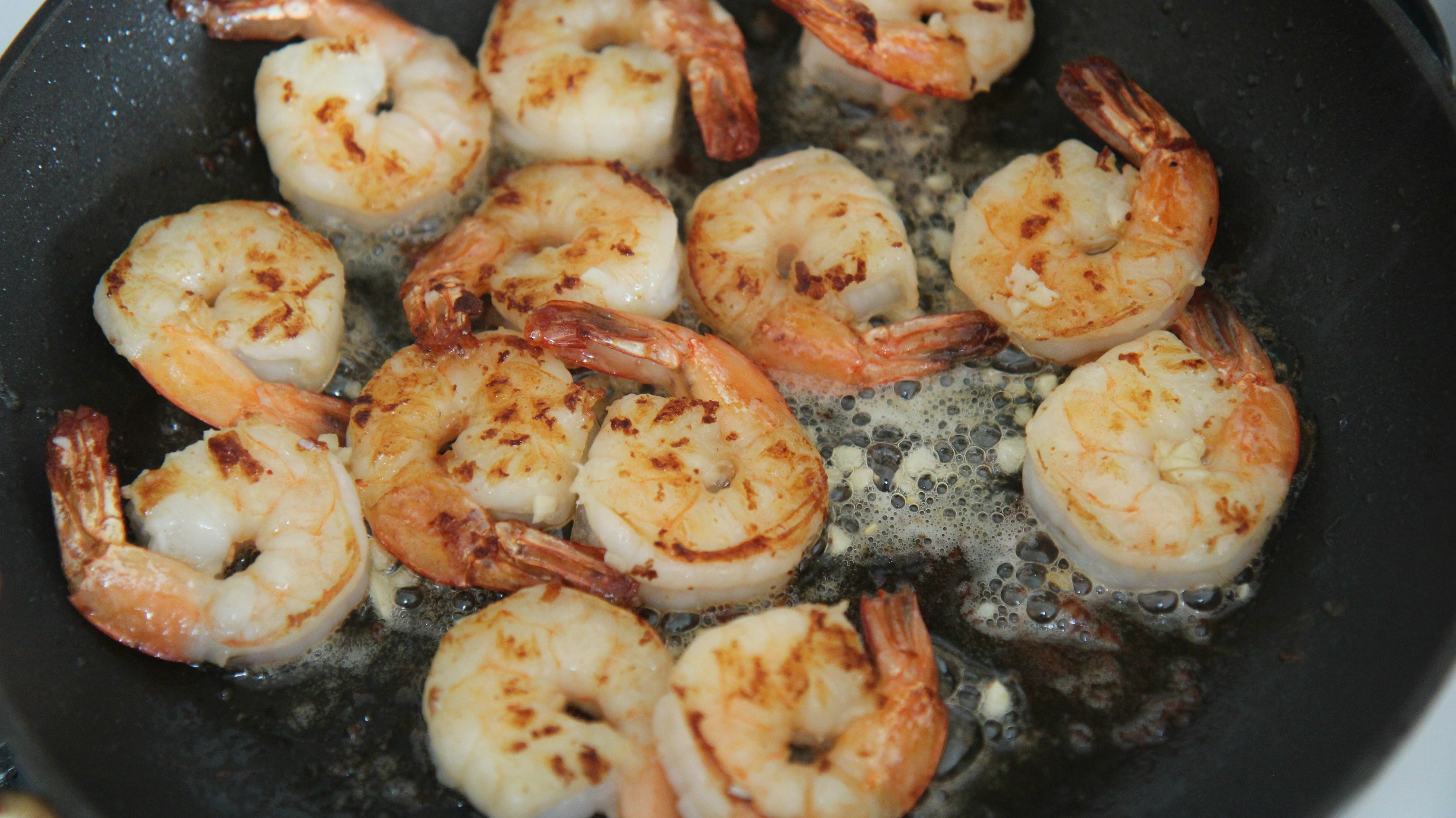 shrimp in a black skillet