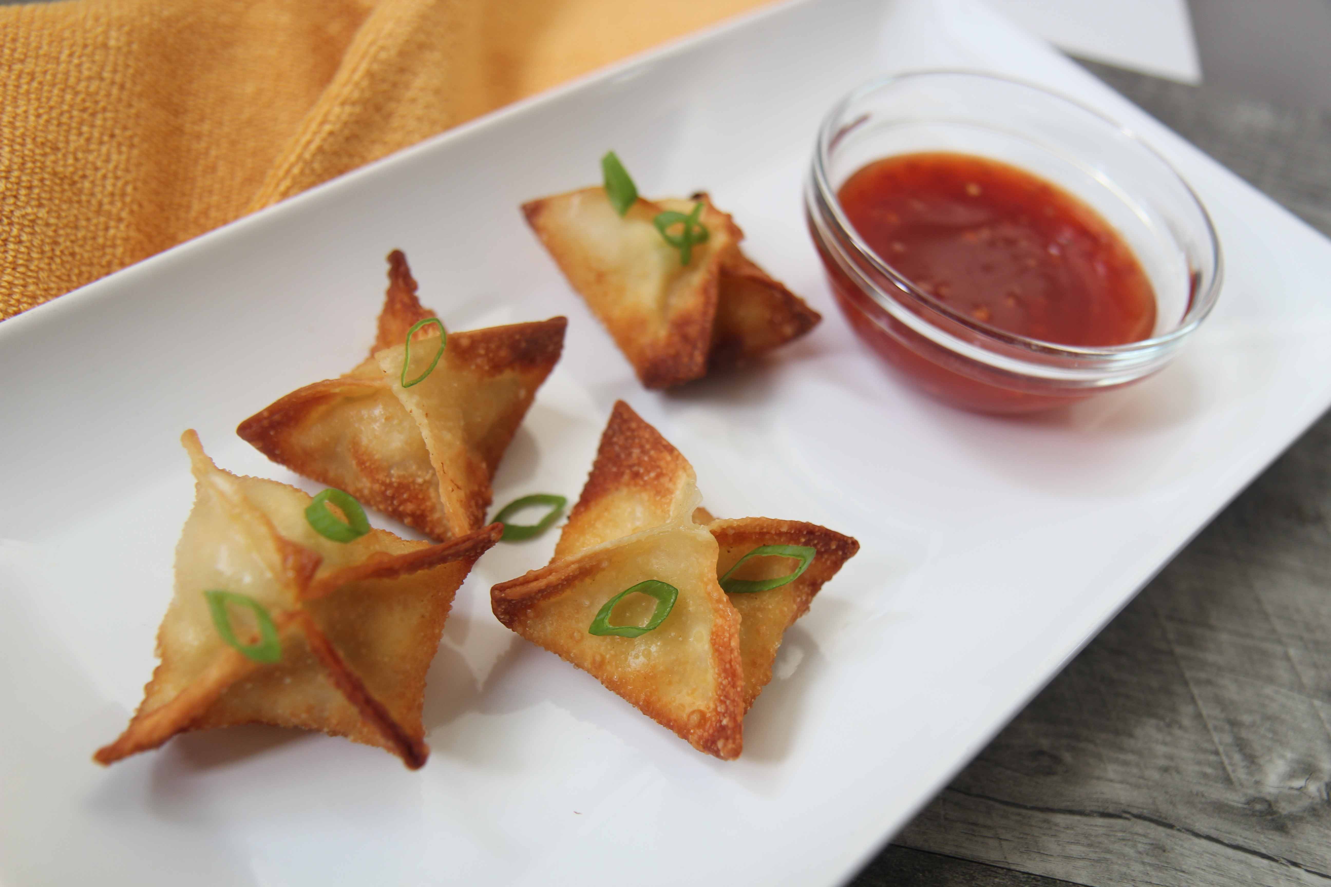 Your favorite takeout side dish can now be made at home. Try these easy crab ragoons today.