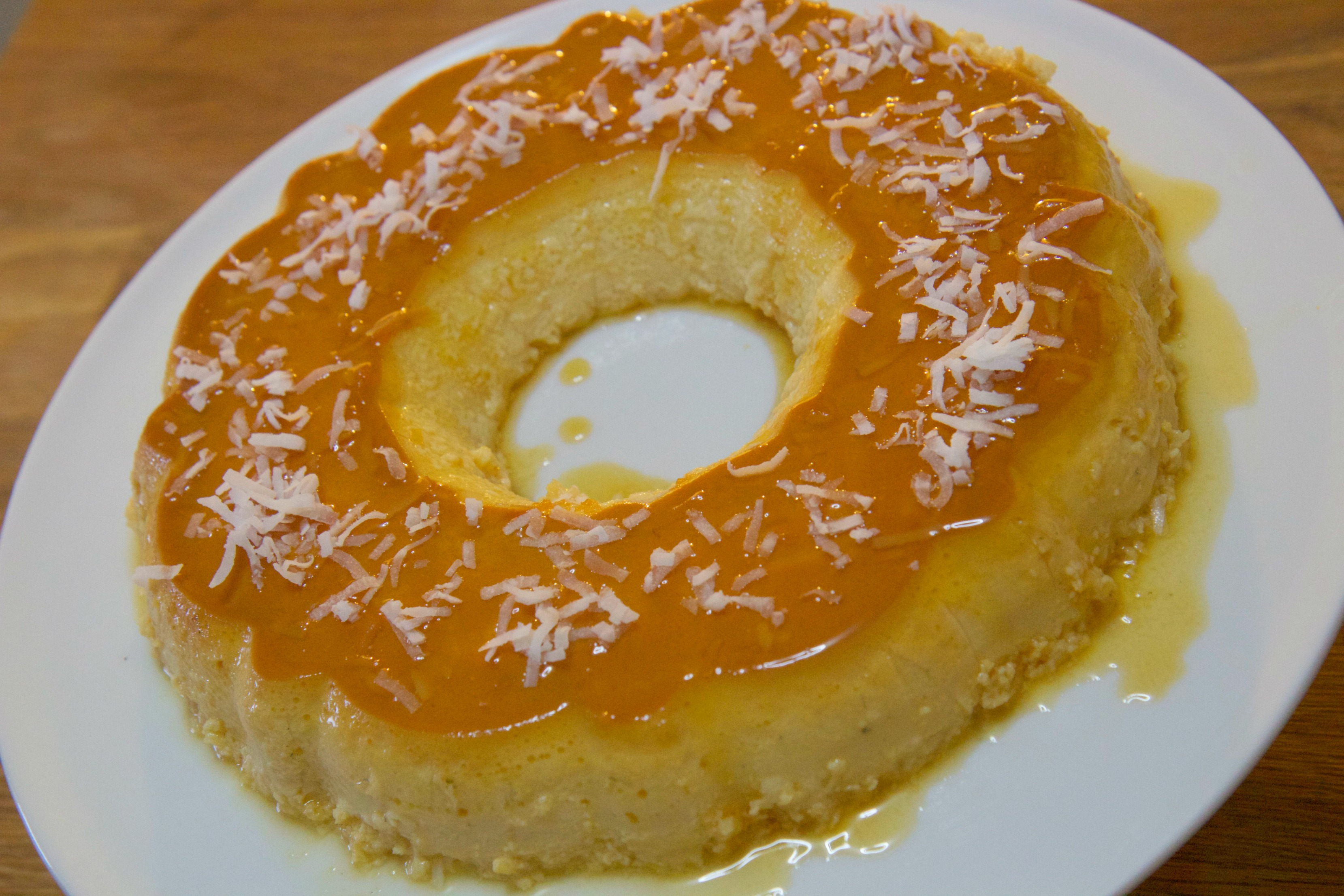 Coconut flan topped with shredded coconut