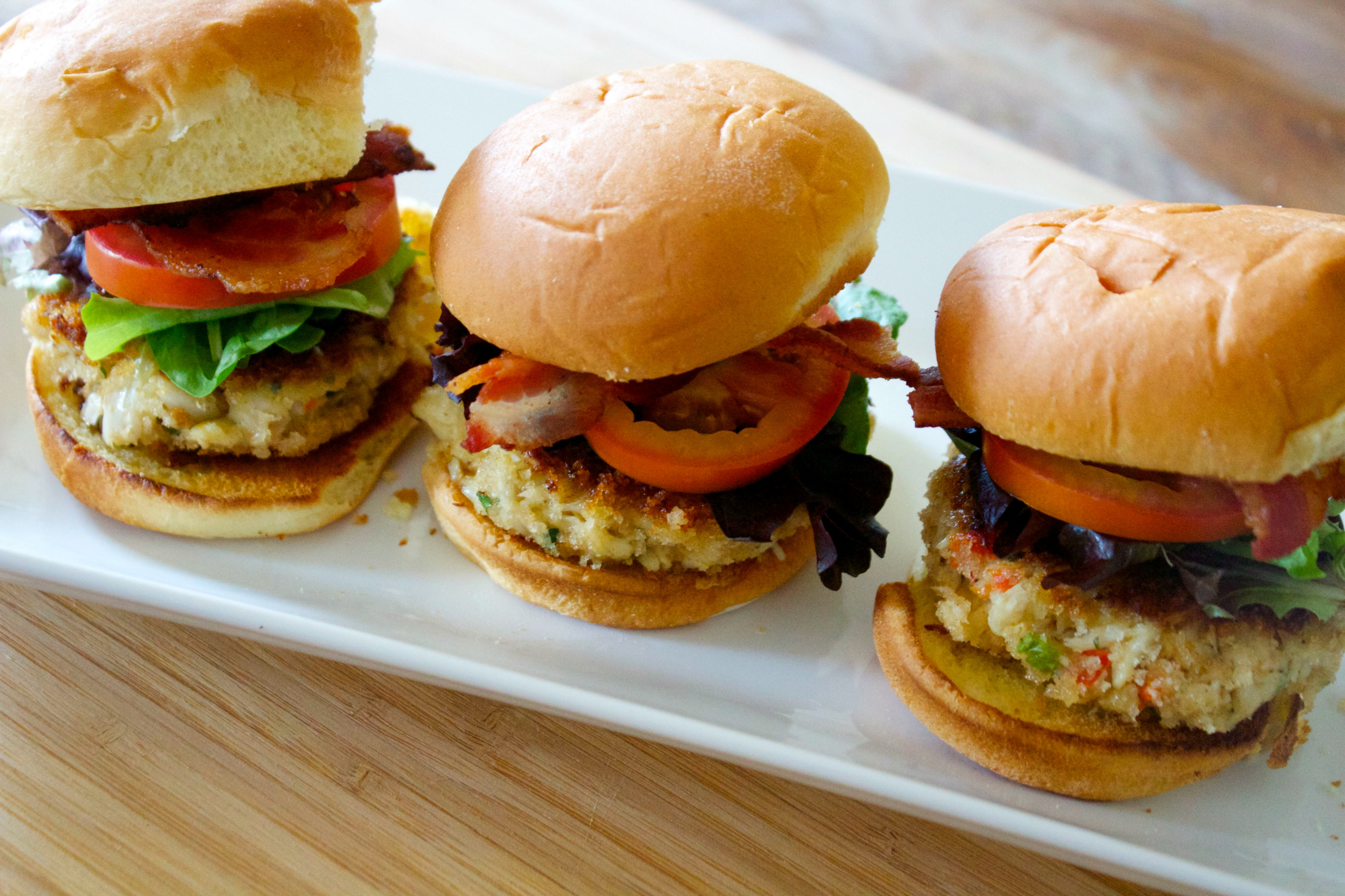 Crab sliders with bacon, lettuce, and tomato.