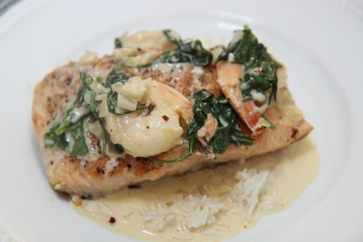 salmon and shrimp over white rice.
