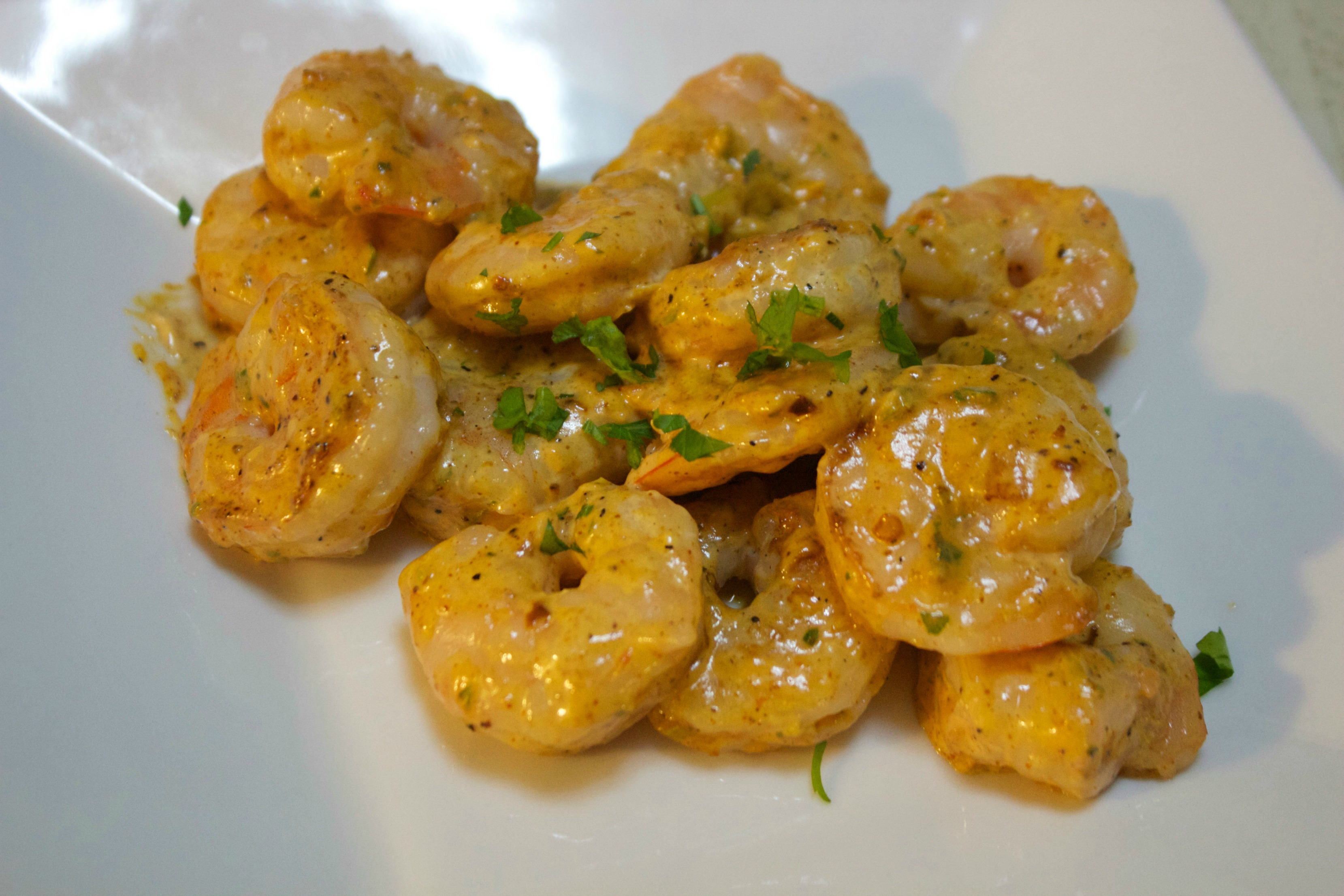 Shrimp coated in a remoulade sauce.